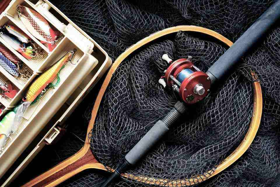 Fishing rod with a fishing net and lures for trout fishing